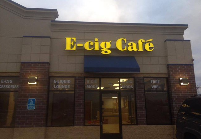 This is an illuminated channel letter design for E-Cig Cafe in Coon Rapids Minnesota made with LED technology.